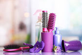 Hair brushes, hairdryer, straighteners and cosmetic bottles in beauty salo — Zdjęcie stockowe