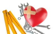 Heart and tools. Concept: Renovation of heart. Isolated on white — Stock Photo