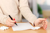 Write off exam on wooden table on room background — Stock Photo