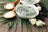 Composition with cosmetic clay for spa treatments, on bamboo background — Foto de Stock