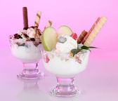Ice cream with wafer sticks on pink background — Stok fotoğraf