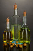 Original glass bottles with oil isolated on black — Stock Photo