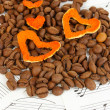 Decorative hearts from dry orange peel with coffee beans on musical notes — Stock Photo #22635429