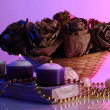 Stock Photo: Still life with roses and candles on color background