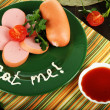 Stock Photo: Sausage, greens, tomato on plate on wooden table