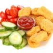 Fried chicken nuggets with sauce and vegetables isolated on white — Stock Photo