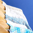 Men's shirts on hangers on blue background — Stock Photo