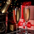 Celebratory champagne with stemware on Christmas lights background - Stock Photo