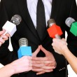 Stock Photo: Conference meeting microphones and businessman