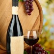 Composition of wine, wooden barrel and grape, on bright background — Stock Photo #22648705