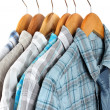 Shirts with ties on wooden hangers on light background — Foto de Stock