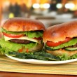 Big and tasty hamburgers on plate on table in cafe — Stock Photo