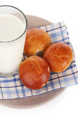 Bread rolls and glass of milk isolated on white — Stock Photo