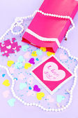 Beautiful composition of paper valentines and decorations on purple background close-up — Stock Photo