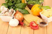 Vegetarian lasagna ingredients on wooden background — Stock Photo
