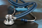 Medical stethoscope on an x-ray picture close up — Stock Photo
