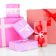 Gift boxes, festive wrapping isolated on white - Stock Photo