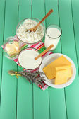 Glass of milk and cheese on a wooden background — Stok fotoğraf