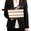 Woman holding wooden gavel and law books isolated on white — Stock Photo #22679895