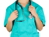 Doctor with stethoscope in hands isolated on white — Stock Photo
