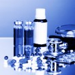 Medicines and stethoscope in blue light — Foto Stock