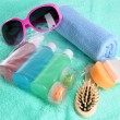Hotel cosmetics kit on blue towel — Stock Photo
