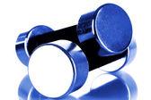 Dumbbells in blue light — Stock Photo