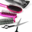 Постер, плакат: Comb brushes hairdryer and cutting shears isolated on white