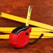 Tape measure and ruler on wooden background - Stock Photo