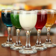 Stock Photo: Tasty color liquors, on bright background