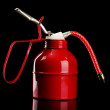 Oil can on black background — Stock Photo