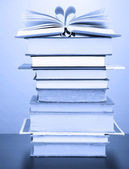 Stack of books in dark blue light — Stock Photo