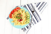 Rigatoni pasta dish with tomato sauce on white wooden table — Stock Photo