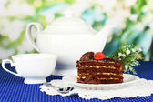 Teapot, cup of tea and delicious cake on window background — Stok fotoğraf