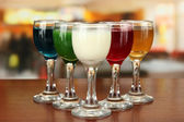 Tasty color liquors, on bright background — Stock Photo