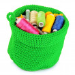 Colorful yarn for knitting in green basket isolated on white — Stock Photo #22720941