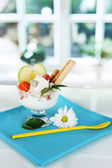 Ice cream with wafer sticks on blue napkin on window background — Stock Photo