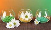 Sea salt in different colors in glass containers on bright background — Stock Photo