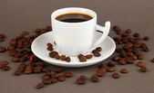 Cup of strong coffee on grey background — Stock Photo