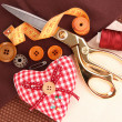 Sewing accessories and fabric close-up — Stock Photo #22791730