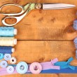 Sewing accessories and fabric on wooden table close-up — Stock Photo #22791742