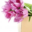 Beautiful bouquet of purple tulips in paper box, isolated on white — Stock Photo #22792938