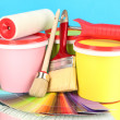 Set for painting: paint pots, brushes, paint-roller, palette of colors on blue background — 图库照片