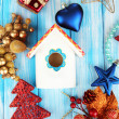 Nesting box and Christmas decorations on blue background — Foto Stock
