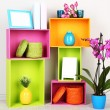 Beautiful colorful shelves with different home related objects — Stock Photo #22793728