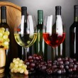 Assortment of wine in glasses and bottles on grey background — Stock Photo #22793944