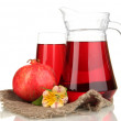 Royalty-Free Stock Photo: Full glass and jug of pomegranate juice and pomegranate isolated on white