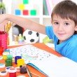 Cute little boy painting in his album — Stock Photo #22797078