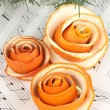 Decorative rose from dry orange peel on musical notes — Stok fotoğraf