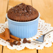 Stock Photo: Cupcake in bowl for baking on wooden table